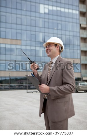 Construction engineering worker/manager talking on radio