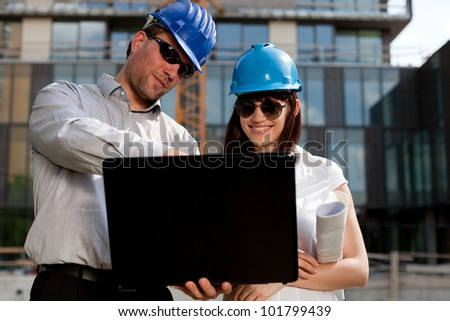 Construction engineers / specialists planning at a construction site