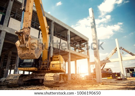 construction equipment in construction new warehouse background - Shutterstock ID 1006190650