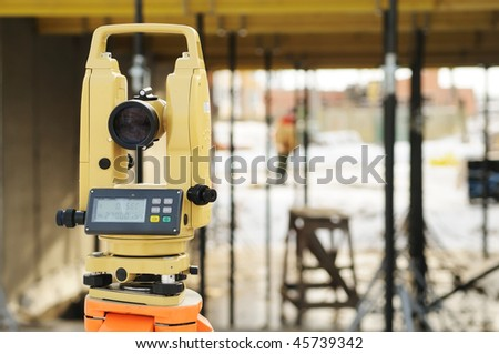 construction equipment theodolite at building site of modern house