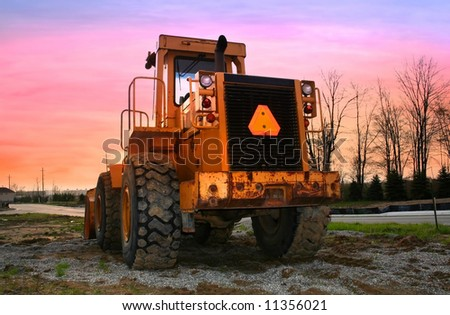Construction equipment with bright colored sky background