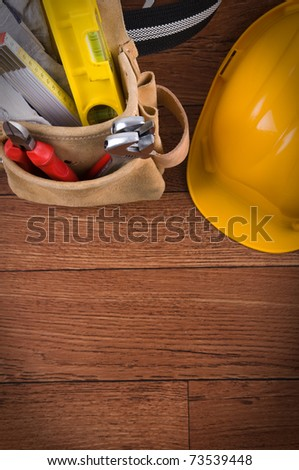 Construction equipments on wood background with copy space - a series of CONSTRUCTION IMAGES.