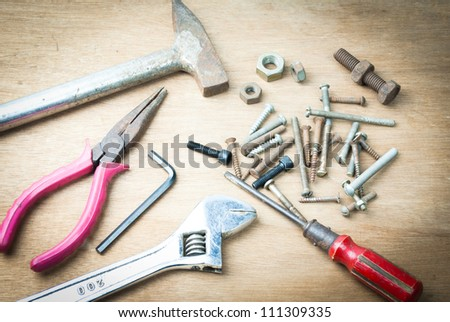 Construction Equipments / Tools on wood board