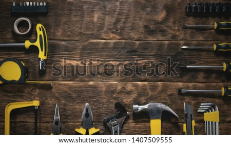 Construction flat lay background with copy space. Work tools on a wooden workbench. #1407509555