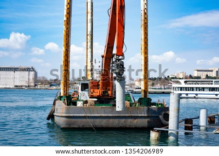 Construction for Marine works this picture for Construction Bert and Jetty, Construction Steel Pipe Pile used Piling Barge for driven pile.