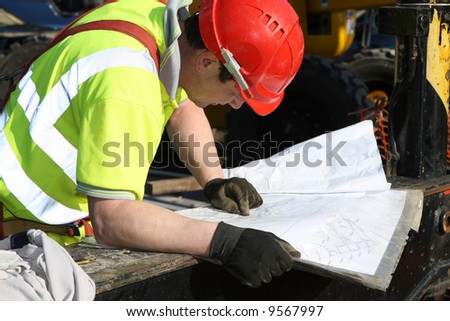 Construction foreman checking drawings