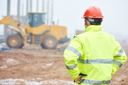 construction foreman worker is watching building works on site