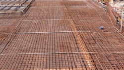Construction industrial steel metal rods wire tied structure close-up for concrete cement pouring onto floor platform outdoor building.