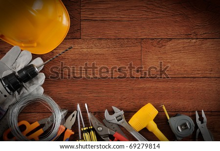 Construction instrument on wood background with copy space.