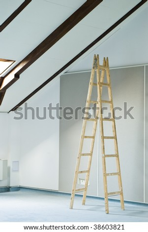construction interior with stepladder and wall