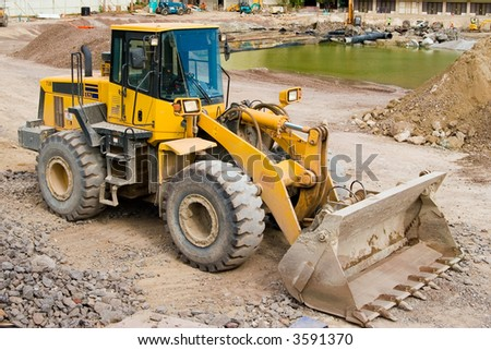Construction loader at a job site ready to work - stock photo