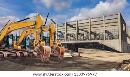 construction machinery and machines on the factory building site