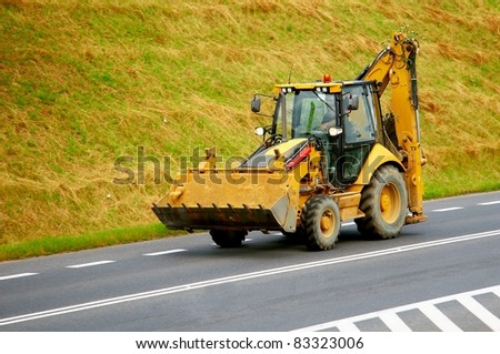 Construction machinery. Excavator coming back from construction