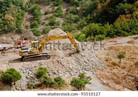 Construction machines at quarry - stock photo