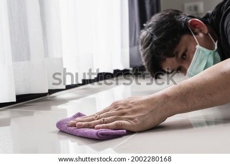 Construction man cleaning tile floor finishing using thinner Stock photo ©