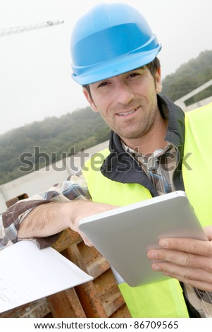 Construction manager using electronic tablet on site