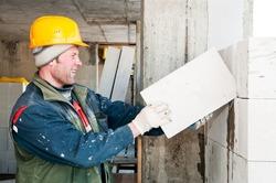 construction mason builder bricklayer works with lime sand bricks