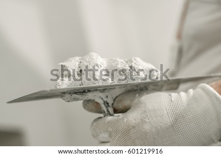 Construction mason worker with spatula and mortar. Construction tools ストックフォト ©