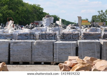 Construction Materials. Building materials for construction houses. Packed stacks of bricks are sold in construction market.