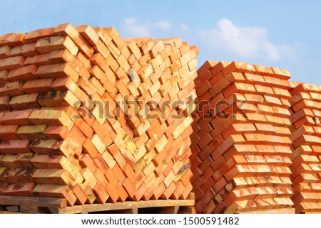 Construction Materials. Building materials for construction of residential complex. Pile of brickwork at construction site.