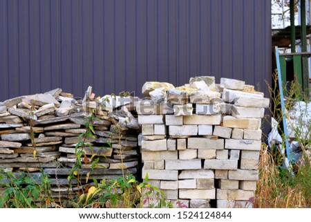 Construction Materials. Building materials for construction of residential house. Pile of brickwork at construction site.