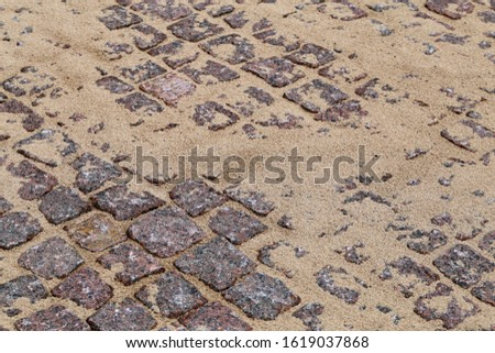 Construction materials in a construction site. In this photo you can see brown sand and red stone material used to create a walkway in Finland. Closeup color image with beautiful textures.