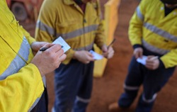 Construction miner workers conducting self risk assessment knowing as take five or taking control step prior to work of each task