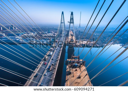 Construction of a bridge across the river. stock photo