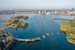 Construction of a bridge at the weerwater lake in the center of Almere, part of the Floriade 2022 expo project. Aerial view.