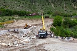 Construction of a bridge in a mountain village. Mountain Digoria. North Ossetia. Russia.