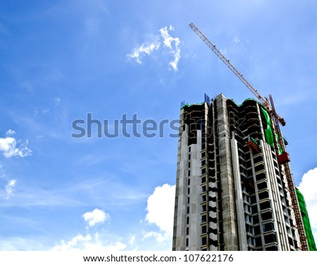 Construction of a building with blue sky - stock photo