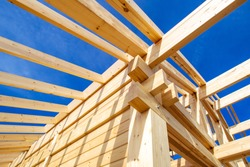 Construction of a house made of laminated veneer lumber. Construction of the roof of the house. Wooden house.