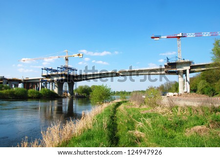 Construction of a large bridge across the river - stock photo