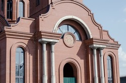 Construction of a new Building Modern Ukrainian Christian Orthodox Church. Redbrick building with arches and columns. Religion, a symbol of faith. Christian Architecture.