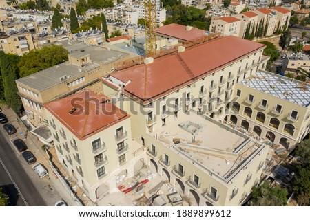 Construction of a new hotel, in the German colony of Haifa. Near the Baha'i Gardens   Stock fotó ©
