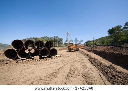 Construction of a new oil pipeline.Machine to twist pipes(pipelaying crane) in a pipeline construction.
