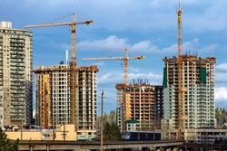 Construction of a new residential area of high-rise buildings near the Sky Train station in the city of New Westminster.