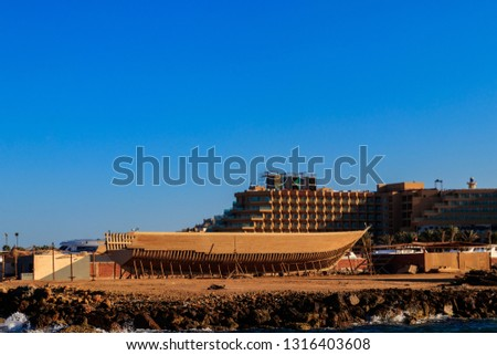 Construction of a ship on Red sea shore in Hurghada, Egypt #1316403608