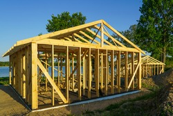 construction of a simple wooden recreation building on the lake shore