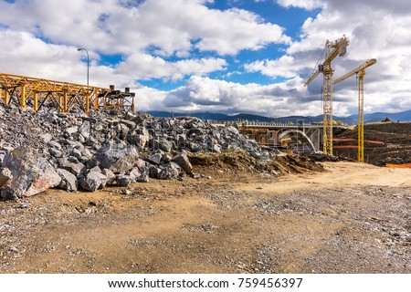 Construction of a viaduct with cranes #759456397