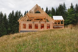 Construction of a wooden cabin in the countryside.