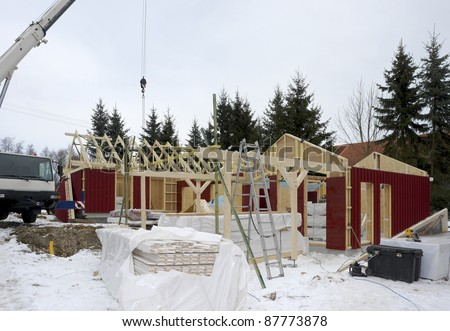 construction of a wooden house at winter time