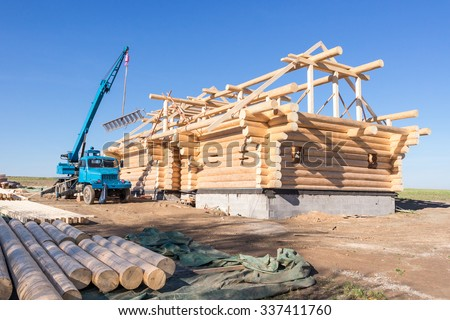 Construction of a wooden house in nature