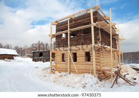 Construction of a wooden house in the rural areas, winter