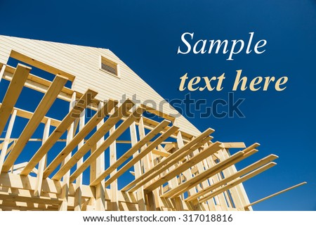 construction of a wooden house in the suburbs