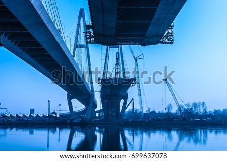 Construction of an automobile bridge across the river. Cable-stayed bridge in St. Petersburg. stock photo
