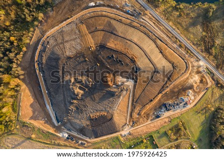 Construction of an embankment during the reclamation of a garbage dump Stockfoto ©
