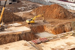 construction of apartment houses, preparation of the Foundation of the house building process