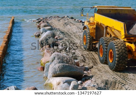 construction of breakwaters, construction equipment on the sea coast, Baltic sea #1347197627