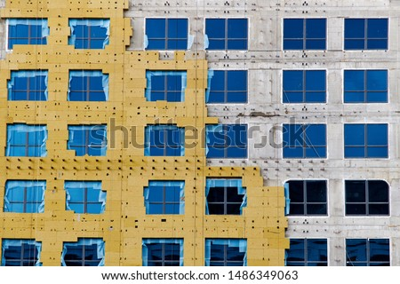 Construction of external wall thermal insulation with rock wool. Exterior passive house wall heat insulation with mineral wool. Insulation the facade of commercial building. Energy efficiency
